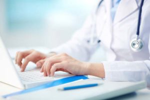 Stock image of doctor on computer